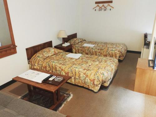 A bed or beds in a room at Old Style Hotel Hakodate Goryokaku
