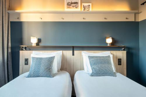 A bed or beds in a room at Hotel Kaijoo by HappyCulture