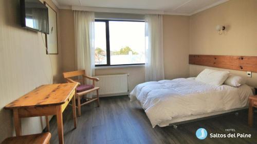 Cama o camas de una habitación en Hotel Saltos del Paine