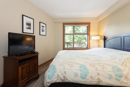 A bed or beds in a room at Lost Lake Lodge by Whistler Premier