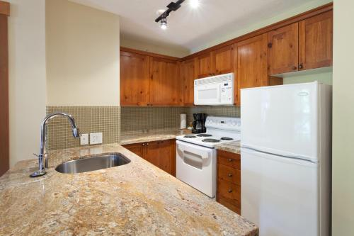 A kitchen or kitchenette at Lost Lake Lodge by Whistler Premier