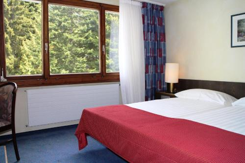 A bed or beds in a room at Eurotel Victoria