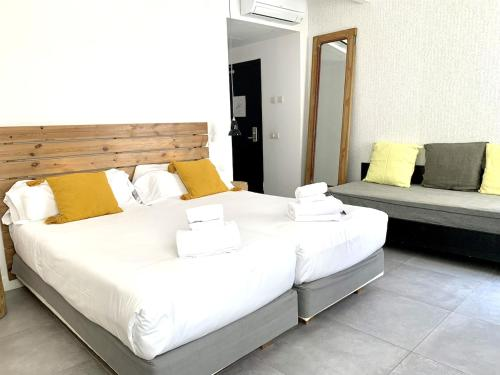 A bed or beds in a room at Eco Boutique Hostal Grau