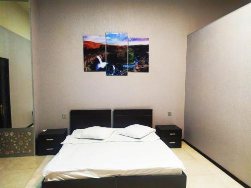 Cama ou camas em um quarto em Bliss Inn Boutique Hotel