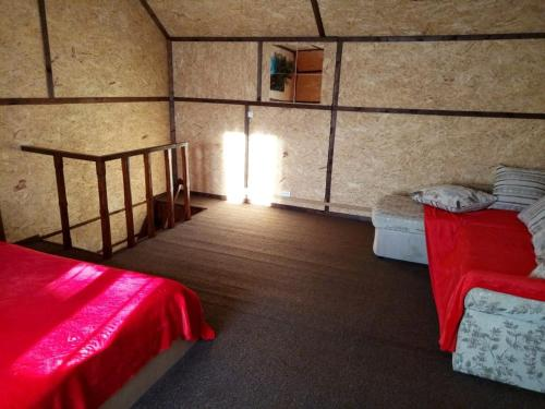 A bed or beds in a room at Guest House Bukahouse