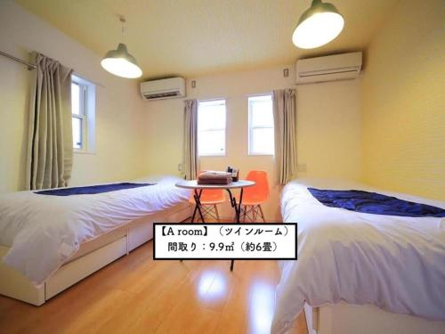 A bed or beds in a room at Cozy Inn 東京桜新町