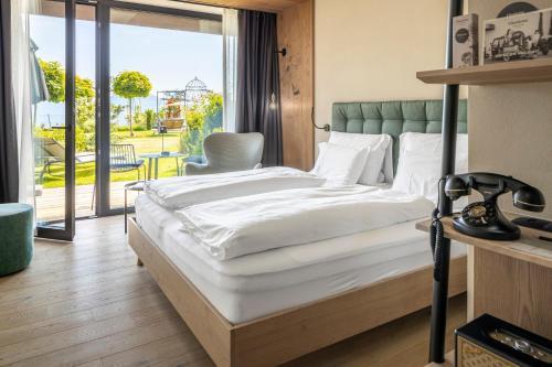 Ein Bett oder Betten in einem Zimmer der Unterkunft Gloriette Guesthouse
