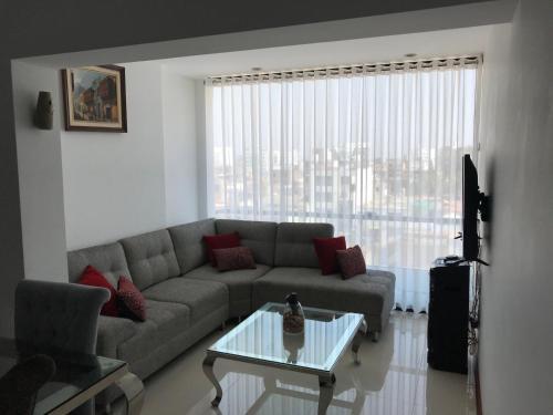 A seating area at Excelente Dpto en Surquillo a tu disposición!!!