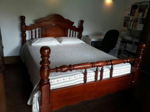 A bed or beds in a room at Casa Confort Pampulha