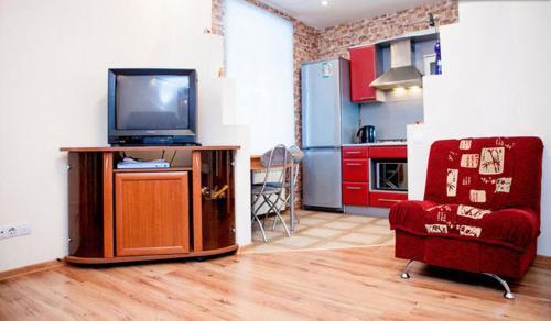 Телевизор и/или развлекательный центр в Большая Морская апартаменты
