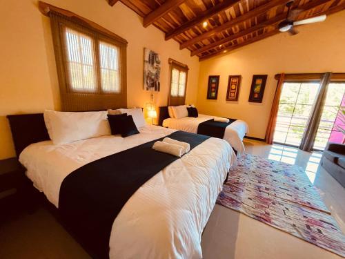 Cama o camas de una habitación en Millenium Manuel Antonio