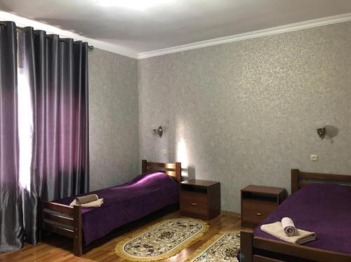 Кровать или кровати в номере Hotel AMBO