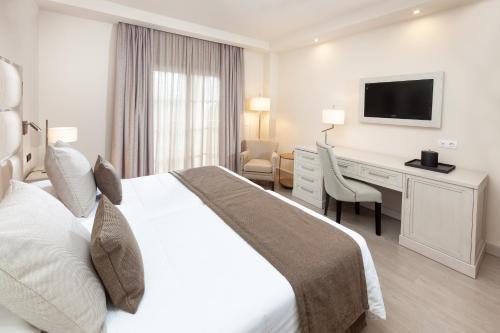 Cama o camas de una habitación en Hotel RIU Garoé