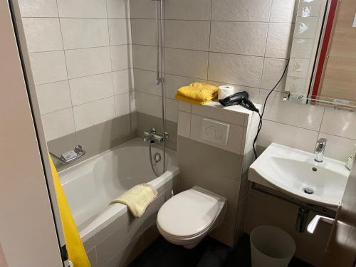 Ein Badezimmer in der Unterkunft Hotel Elite Täsch