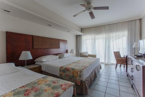 A bed or beds in a room at Sauipe Resorts - All Inclusive