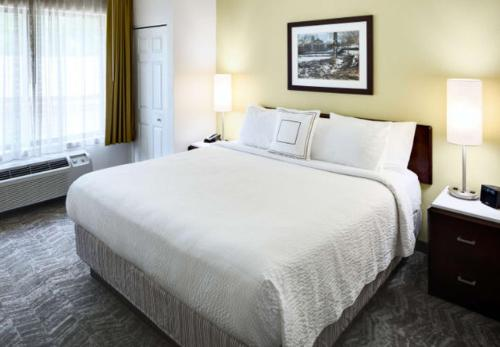 A bed or beds in a room at SpringHill Suites Milford