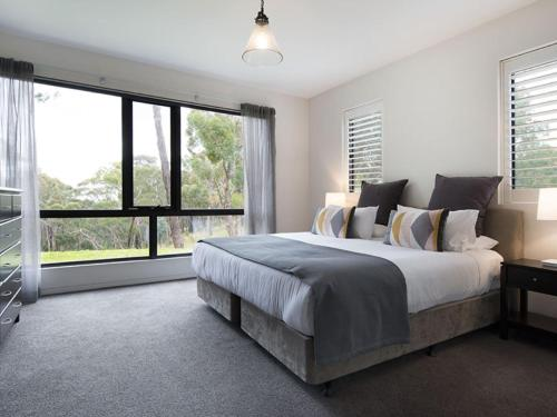 A bed or beds in a room at Edge Daylesford