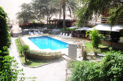 The swimming pool at or near Hotel El Huacachinero