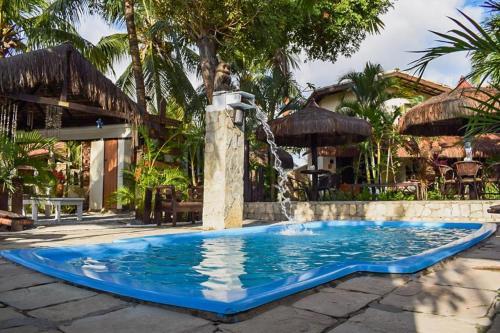 A piscina localizada em Pousada Recanto da Coruja ou nos arredores