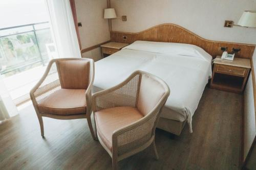 A bed or beds in a room at Bobby Executive