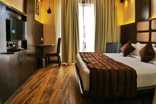 A bed or beds in a room at The Raas Mahal Hotel