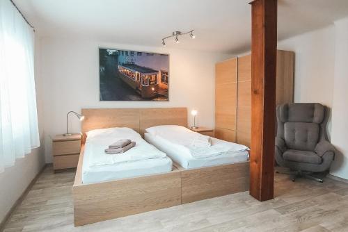 Postel nebo postele na pokoji v ubytování Vila Šumná