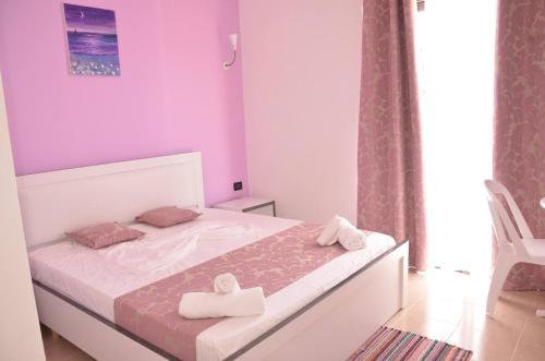 Ліжко або ліжка в номері Viola Garden Hotel Restaurant