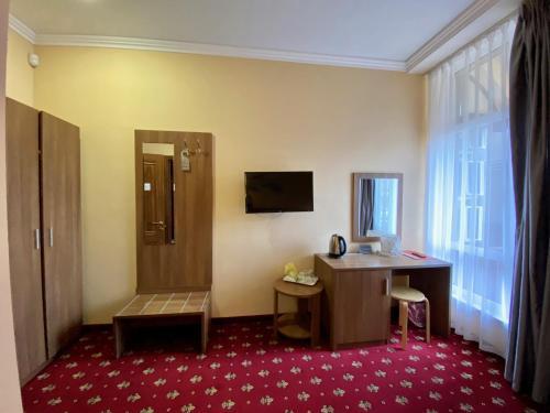 Телевизор и/или развлекательный центр в Бутик-отель «Чкалов»