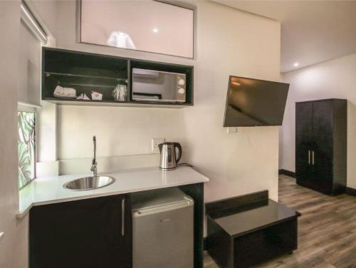 A kitchen or kitchenette at Parade Hotel