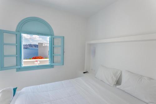 Un ou plusieurs lits dans un hébergement de l'établissement Villa Maria Rooms