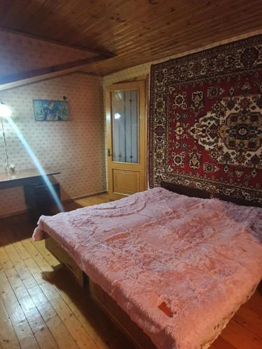 A bed or beds in a room at Guest House Raisa