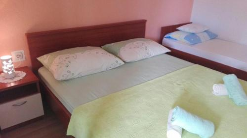 Posteľ alebo postele v izbe v ubytovaní Apartment Peris
