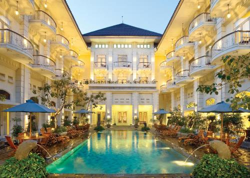 The swimming pool at or near The Phoenix Hotel Yogyakarta - MGallery Collection - GeNose Ready, CHSE Certified