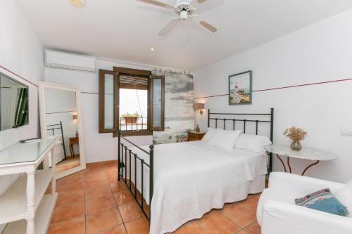 Een bed of bedden in een kamer bij La Morada Mas Hermosa