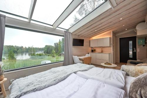 A bed or beds in a room at Varjola Holiday Center