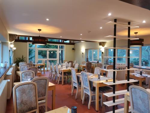 A restaurant or other place to eat at Logis Hotel Le Relais De La Poste