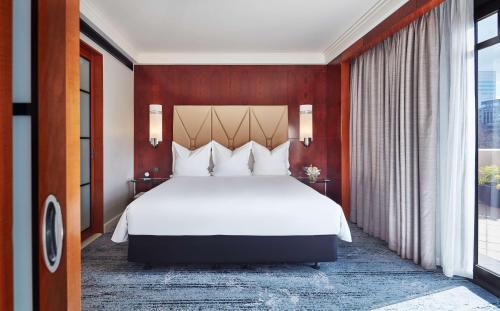 A bed or beds in a room at Park Hyatt Melbourne