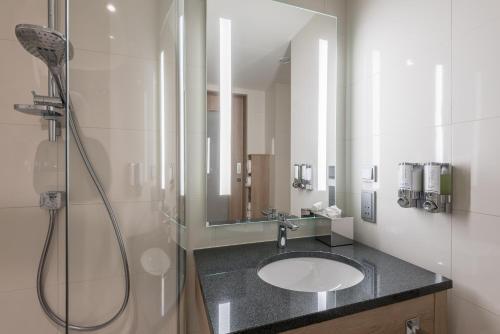A bathroom at Hampton By Hilton Freiburg