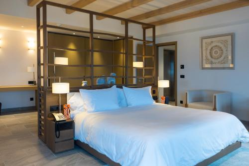 A bed or beds in a room at Angsana Corfu Resort & Spa