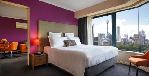 A bed or beds in a room at Pullman Sydney Hyde Park