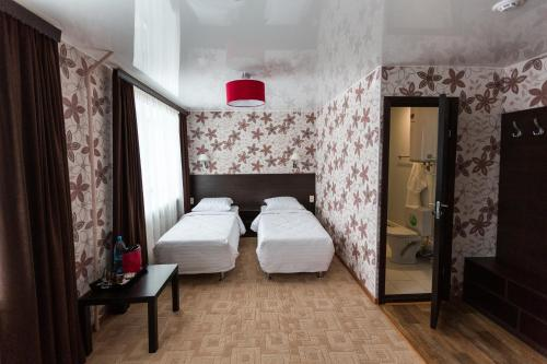 Кровать или кровати в номере Отель Сияние