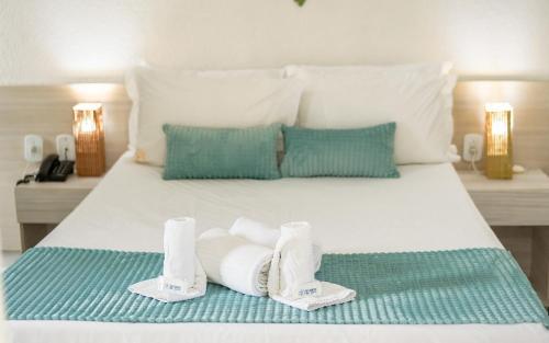 Cama ou camas em um quarto em Recanto da Orla