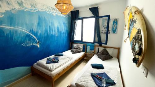 A bed or beds in a room at Red Star Surf & Yoga Camp Lanzarote