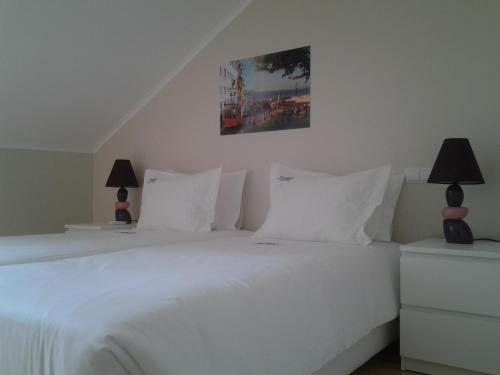 Letto o letti in una camera di Sincerely Lisboa