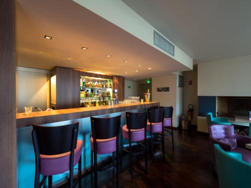 The lounge or bar area at Hotel du Casino