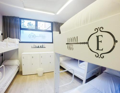 A bunk bed or bunk beds in a room at Room018BCN