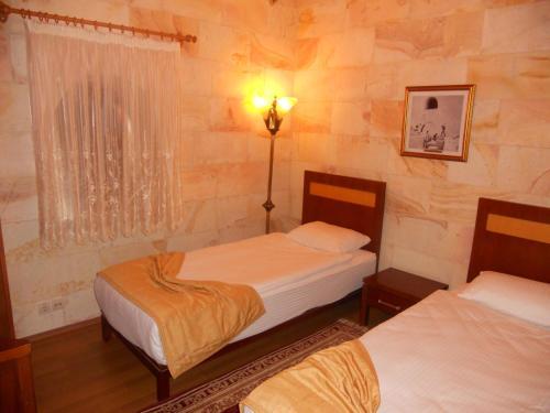 Cama o camas de una habitación en Uchisar Kaya Otel