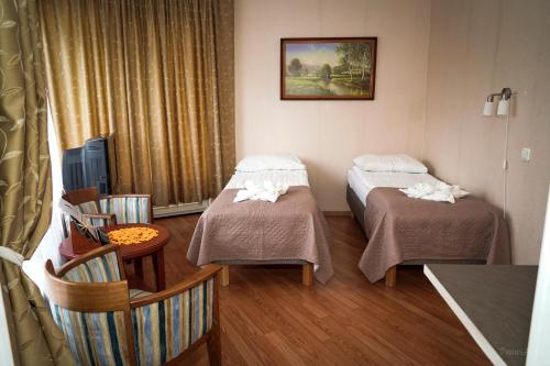 A bed or beds in a room at Humala Guest House