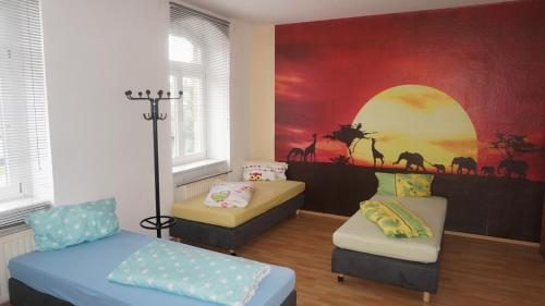 A bed or beds in a room at Hostel Falkenstein