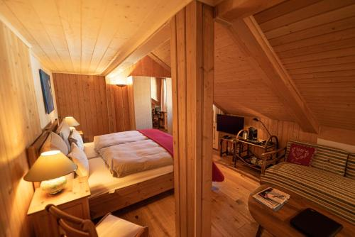 A bed or beds in a room at Boutique Hotel Alpenrose